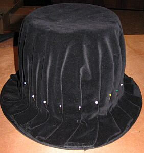 2522a3146f5 I pinned a  circle  of velveteen to the hat to make folds. This was then  tacked down with handsewing.